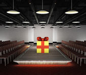 Gift box situated on fashion podium — Stock Photo