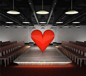 Big red heart situated on fashion podium — Stock Photo
