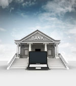 New laptop in front of bank in classic style with sky — Stockfoto