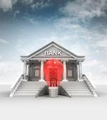 Red lightbulb in front of bank in classic style with sky — Stock Photo