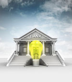 Yellow lightbulb in front of bank in classic style with sky — Stock Photo