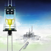 Champion cup in sky space elevator concept above city — ストック写真