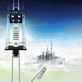 Telephone in sky space elevator concept above city — Stock Photo
