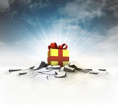 Gift wrapping stuck into ground with flare and sky — Stock Photo