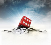 Lucky dice stuck into ground with flare and sky — Stock Photo