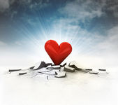 Red heart stuck into ground with flare and sky — Stock Photo