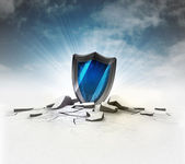 Security shield stuck into ground with flare and sky — Stock Photo