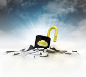 Open padlock stuck into ground with flare and sky — Stock Photo