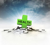 Health icon stuck into ground with flare and sky — Stock Photo