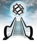 Movie tape in bubble above escalator leading to sky concept — Stock Photo