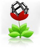 Movie tape in red flower blossom — Stockvector