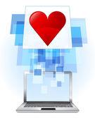 Red heart in laptop — Stock Vector