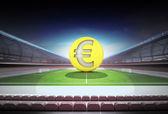 Euro golden coin in midfield of magic football stadium — Stock Photo