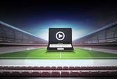 Laptop internet football watch in midfield of football stadium — Stock Photo