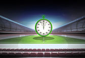 Training stopwatch in midfield of magic football stadium — Stock Photo