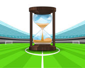 Hourglass countdown in the midfield of football stadium — Stock Vector