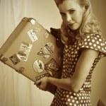 Pretty retro woman with suitcase — Stock Photo #11995620