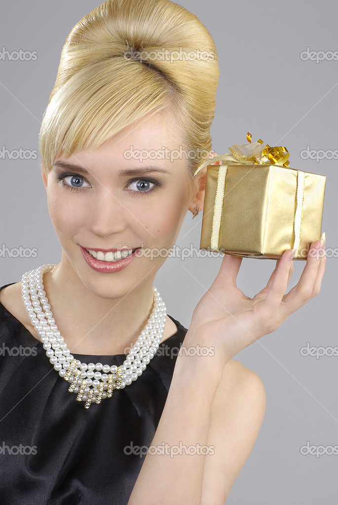 Blonde woman holding gift box   Stock Photo #12103271
