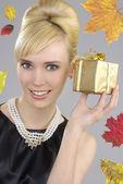 Blond woman holding gift box — Stock Photo