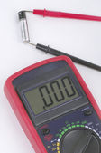 Battery with digital multimeter — Stock Photo