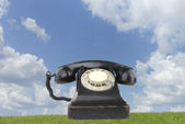 Old vintage phone on grass — Stock Photo