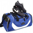 Sport footwear. Soccer boots and bag. - Stock Photo