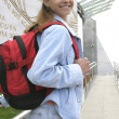 Active woman with backpack — Stockfoto