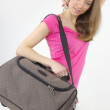 Stock Photo: Atractive woman with travel bag