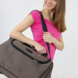 Atractive woman with travel bag — Stock Photo