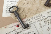 Old key with postcards — Stock Photo