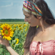 Girl and sunflower — Stock Photo