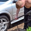 A man washes the car. - Stock Photo