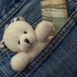 Постер, плакат: Pocket of jeans with childs toy and money