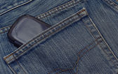 Pocket of jeans with a mobile telephone. — Stock Photo