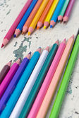 Colors pencils are on a background from a tree — Stock Photo