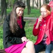 Mother with daughter teenager have a rest in a park in spring — Stock Photo #24486771