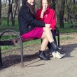 Mother with daughter teenager have a rest in a park in spring — Stock Photo #24486781