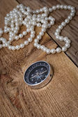 Compass with pearls — Stock Photo