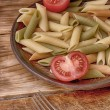 Pasta italiana and tomatoes — Stock Photo
