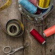 Stock Photo: Instruments of repairmclothing and thread