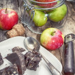Pieces of dark chocolate and red apples — Stock Photo