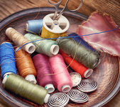 Threads multicolored,button — Stock Photo