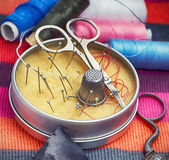 Box with needles and scissors — Stock Photo