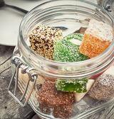 Glass candy jar — Stock Photo