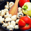 Mushrooms and fresh vegetables on the rusty pan — Stock Photo
