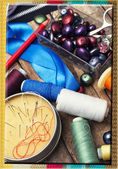 Postcard with the sewing accessories — Stock Photo