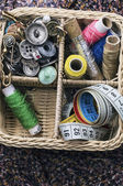 Buttons,threads in wicker basket — Stock Photo