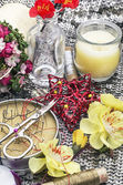 Sewing tools and floral decorations — Stock Photo
