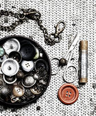Buttons and zipper on the background of sewing tool — Stock Photo