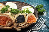 Pancakes stuffed with seafood — Stock Photo